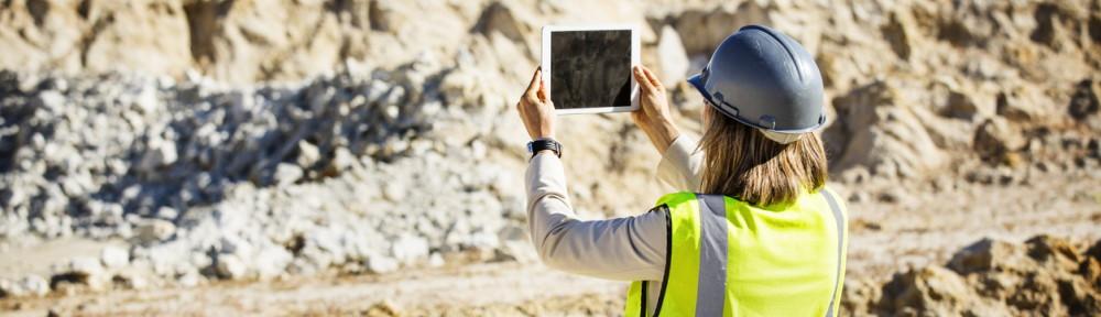 Female architect photographing quarry